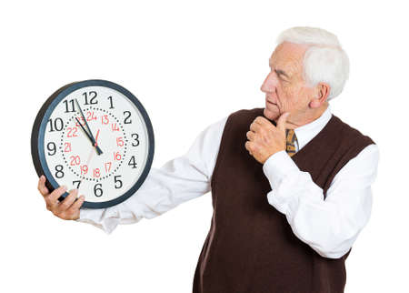 Closeup portrait old business man, funny looking elderly guy, holding clock, stressed, running out, pressured by lack time, aging, late meeting isolated white background. Negative emotion expression photo