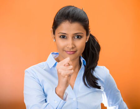 Closeup portrait of young woman gesturing with thumbs, finger that you are going to get zero nothing, isolated on orange red background. Negative emotion facial expression feelings, body language sign photo
