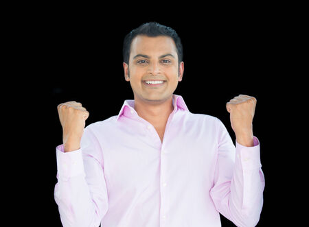 enrolled: Closeup portrait of excited, energetic, happy, student, business man in pink shirt, winning, arms, fists pumped, celebrating success, isolated black background.