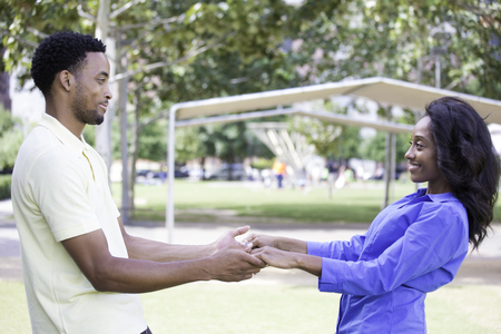 hitched: Closeup portrait, young couple, guy in yellow shirt looking into woman eyes with blue shirt, face to face, holding hands, happy moments, positive human emotions, isolated outside outdoors background