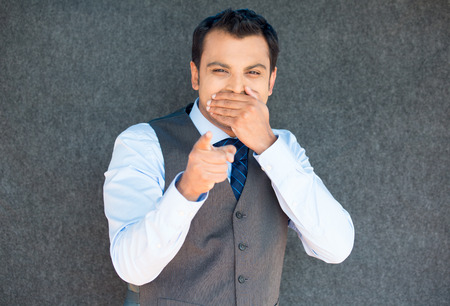isolated on gray: Closeup portrait of handsome excited, manager boss man in vest and tie, happy smile, pointing finger towards at you to the camera gesture, isolated gray background Stock Photo