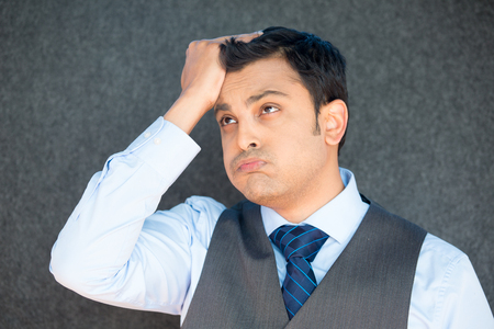 duh: Closeup portrait, stressed young business man with vest and tie, hand on head uh oh, with bad headache, isolated gray black. Negative human emotion facial expression feelings.