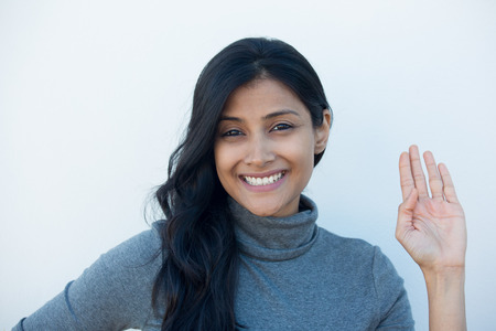 indian teenager: Closeup portrait of young happy, smiling excited beautiful natural woman giving OK sign with fingers, isolated white wall background. Positive emotion facial expressions symbols, feelings attitude