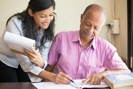 Closeup portrait, woman helping boss sign documents, showing paperwork, keeping records, making appointments, isolated indoors office background