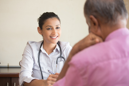Closeup portrait, patient talking good news conversation to healthcare professional, isolated indoors background Stock Photo - 60418129