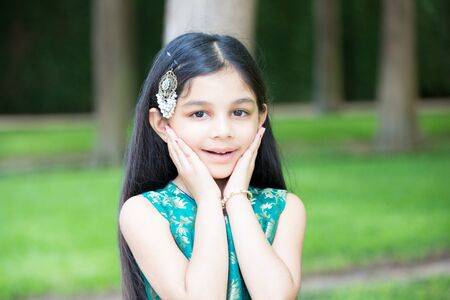 dazzled: Closeup portrait, young girl surprised by what she sees, isolated outdoors outside background