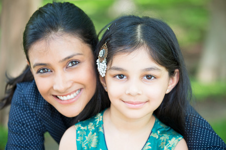 Closeup portrait, family looking at camera, isolated outdoors outside background