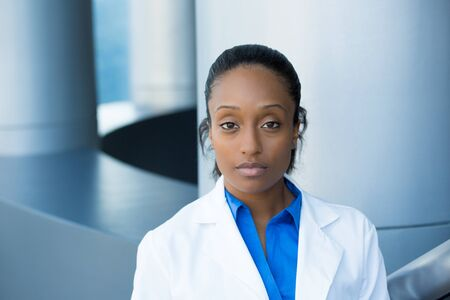 Closeup portrait of friendly, serious confident female healthcare professional with labcoat. Isolated hospital clinic background.