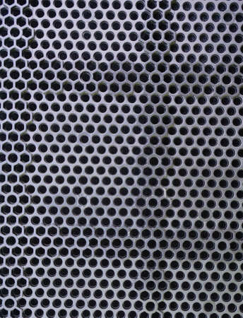 iron grid texture background silver metal pattern with reflective round holes