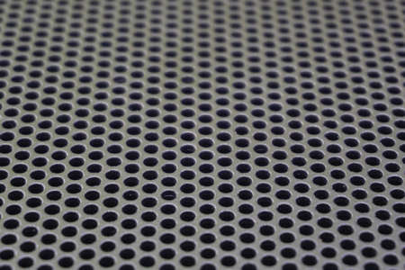 Photo of a loudspeaker grill as a background. Selective focus through the middle. Zdjęcie Seryjne - 130383883