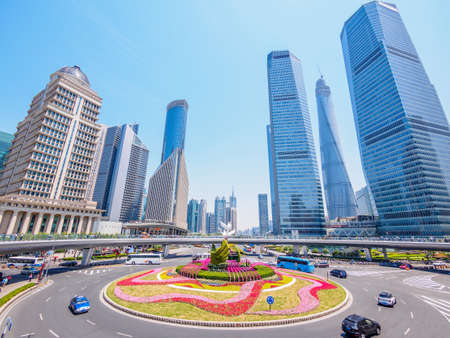 city and grass with blue sky, the modern building of the lujiazui financial center in shanghai china