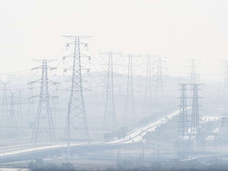 Pylon and power lines in heavy polluted air.