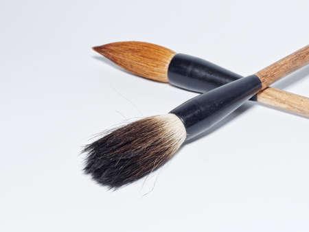 Chinese writing brushes on white background