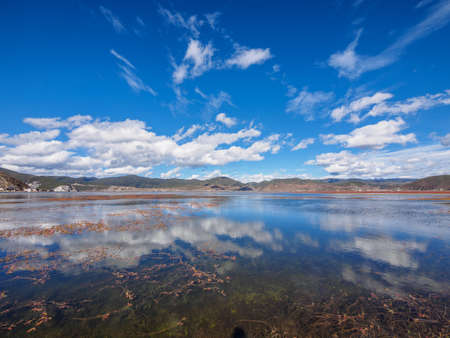 Landscape of beautiful Napa lake and cloud reflection in the water, shangri-la county ,yunnan province,china.