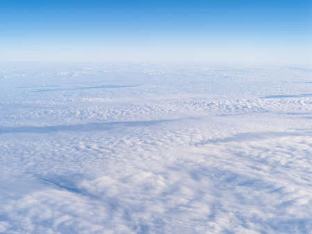 clouds. view from the window of an airplane flying above the clouds.