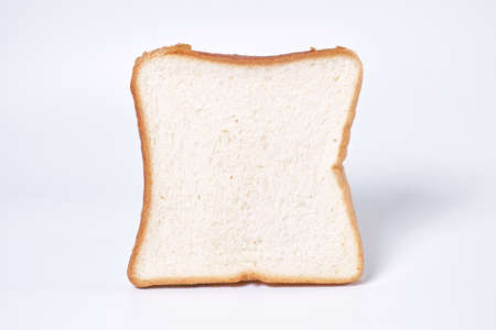 Slice of white bread on white background Banque d'images
