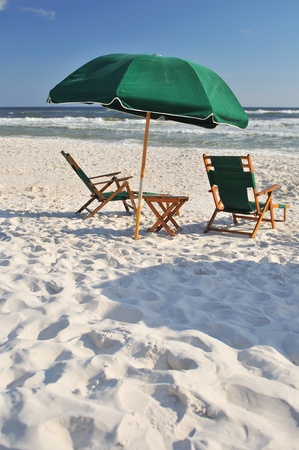 Two empty chairs during holidays on lonely beach Stock Photo - 13368922