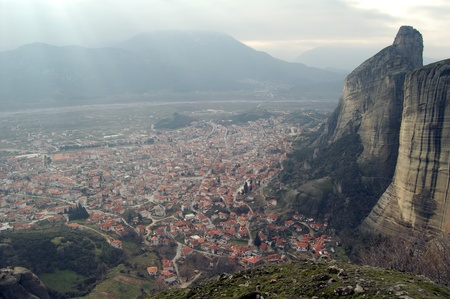 City in the bottom of the mountain photo