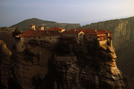 Single monastery on the rock in Greece at sunset Stock Photo - 13461087