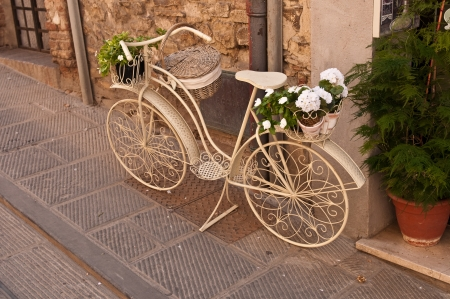 A beautiful old white bicycle on the street in Italy photo