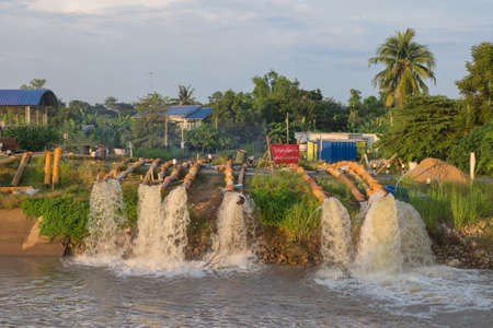 SINGBURI - 2 OCTOBER 2016:Pump protect from flooded area at Inburi district, Singburi province during the flood crisis Editorial
