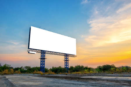 Blank billboard with sky at sunset ready for new advertisement. Stock Photo