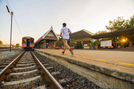 rushed: The boy rushed up train
