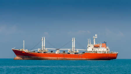 unloading:  Cargo ship at sea in Thailand