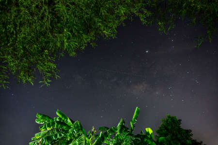 Milky way galaxy with stars and space dust in terraced rice field. (Visible noise due to high ISO, soft focus, shallow DOF, slight motion blur) Stock Photo