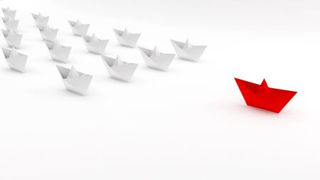 Leadership concept with red paper ship leading among white 写真素材
