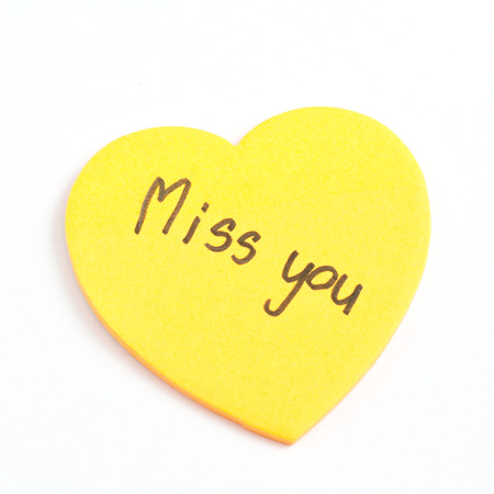 astray: The words Miss You written on yellow heart sticky notes