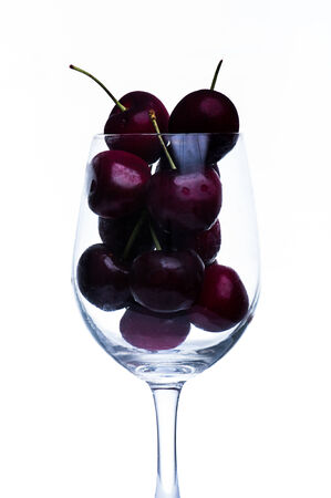 intoxicate: cherry in the glass isolated on white background Stock Photo
