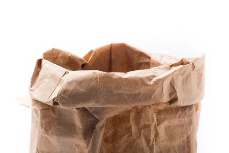 brown paper bag: Brown Paper Bag  with Copy Space Isolated on White Background.