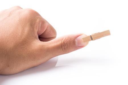 peg: Wooden peg on finger Stock Photo
