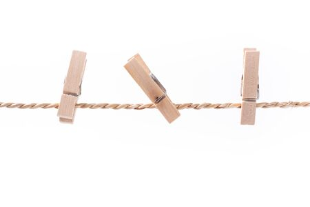 clothespeg: wooden clothespins on a rope