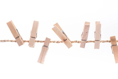 clothes peg: wooden clothespins on a rope