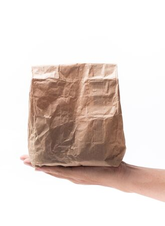 brown paper bag: Brown Paper Bag on hand Isolated on White Background Stock Photo