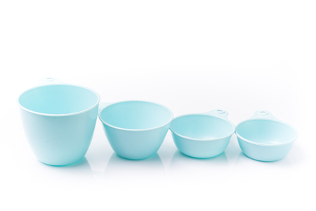 at close quarters: measuring cup on a white background Stock Photo