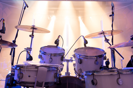band silhouette: drum set on stage,stage lighting