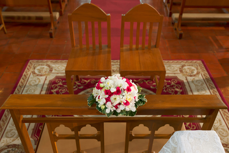 church flower: Bride and grooms chair in church with flower