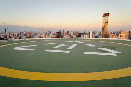 helipad: Helipad with cityscape view