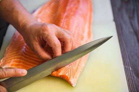 close up chef cutting fresh salmon Stock Photo