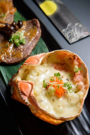 Japanese food, Crab egg with miso paste on king crab shell 免版税图像