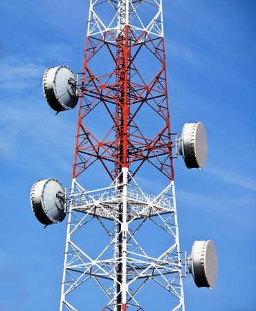 mass media: Transmitter tower with flat parabola Stock Photo