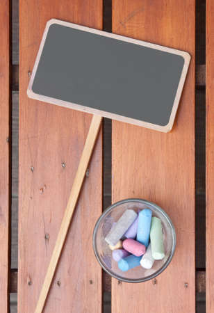Blank chalkboard for text  with chalk stick photo
