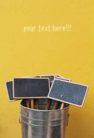 Chalkboard in the pot on yellow background Stock Photo - 12902076