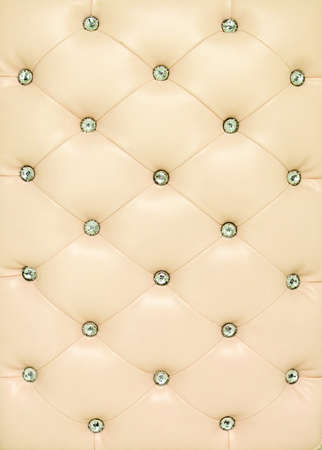 Vintage beige leather background with crytal button photo