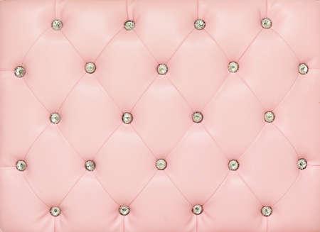 Fondo vintage de cuero rosa con bot�n de cristal Foto de archivo