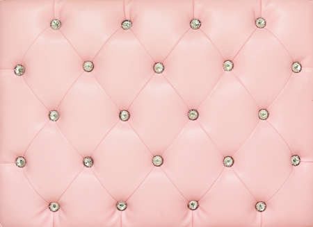 Vintage pink leather background with crystal button photo