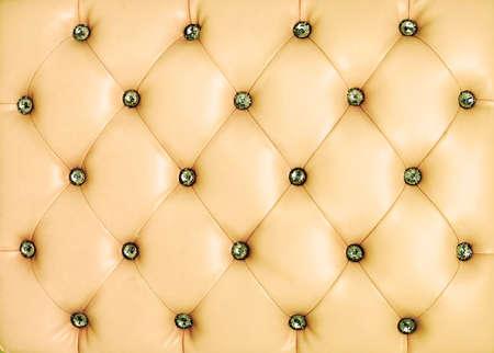 Fondo vintage de cuero amarillo con el bot�n crytal Foto de archivo